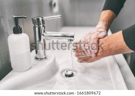 Washing hands rubbing with soap man for corona virus prevention, hygiene to stop spreading coronavirus. Royalty-Free Stock Photo #1661809672