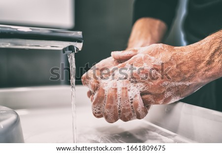 Coronavirus pandemic prevention wash hands with soap warm water and , rubbing nails and fingers washing frequently or using hand sanitizer gel. Royalty-Free Stock Photo #1661809675
