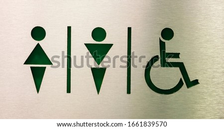 cut toilet sign on stainless-steel , for male , female and disabled person
