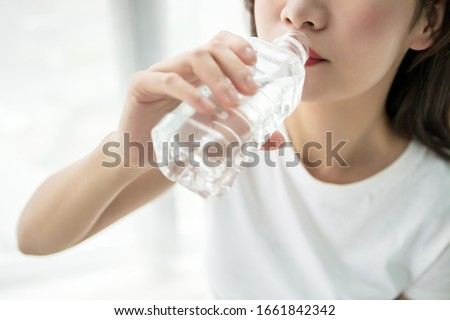 Beautiful young asian woman who drinks water #1661842342