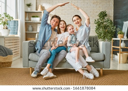 Happy family! Two children daughters with mother and father. Mum, dad and girls laughing and hugging.                                 #1661878084