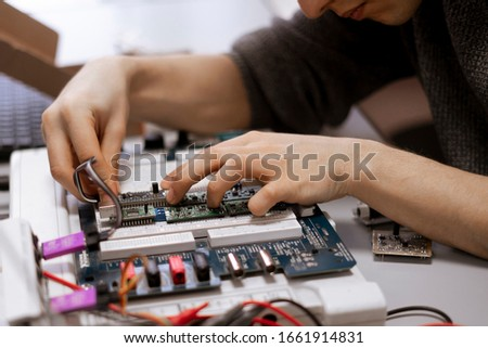 student making measurement and costruct the circuit board with engineer equipment, studying process #1661914831