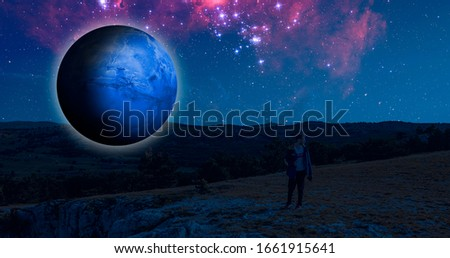 fantasy sci-fi landscape  on the earth with a huge planet in the sky during night elements of this image furnished by nasa