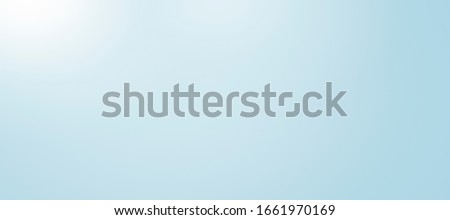 Extreme horizontal light blue wall background