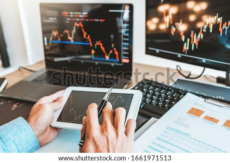 Business man deal Investment stock market discussing graph stock market trading Stock traders concept. Royalty-Free Stock Photo #1661971513
