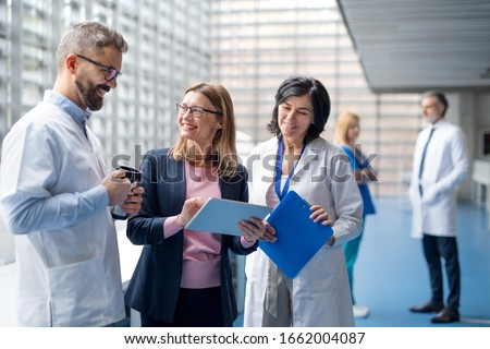 Group of doctors talking to pharmaceutical sales representative. Royalty-Free Stock Photo #1662004087