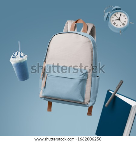 School bag floating with school items advertising photography by