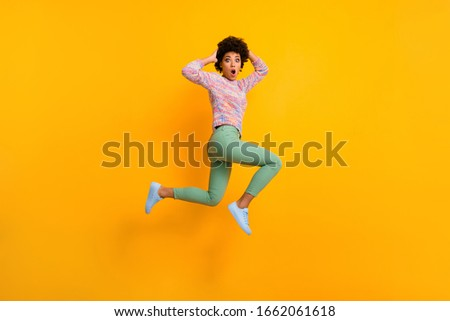 Omg black friday. Full body profile side photo impressed crazy dark skin girl forget she want bargain jump run fast touch hands head wear green colorful outfit isolated bright color background #1662061618