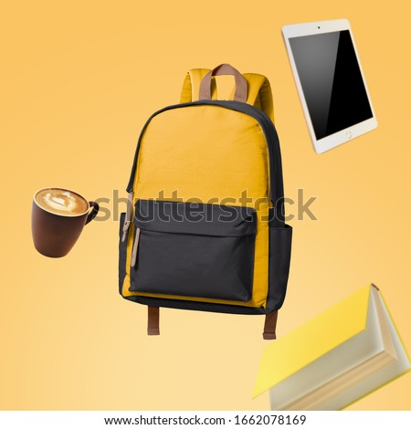 School bag floating with school items advertising photography