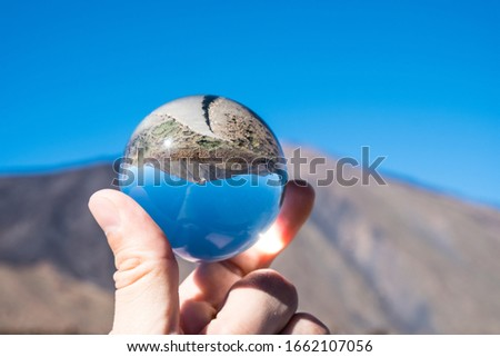 A view of volcano Mount Teide through crystal globe, in Teide National Park, in Tenerife, the highest elevation in Spain #1662107056