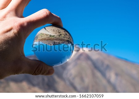 A view of volcano Mount Teide through crystal globe, in Teide National Park, in Tenerife, the highest elevation in Spain #1662107059