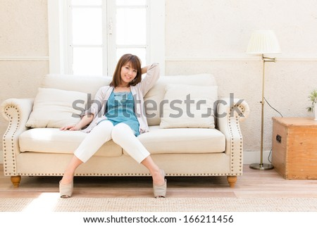young asian woman relaxing on the sofa #166211456