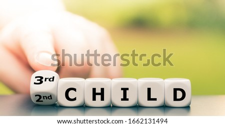 """Expecting a third child. Hand turns dice and changes the expression """"2nd child"""" to """"3rd child"""". #1662131494"""
