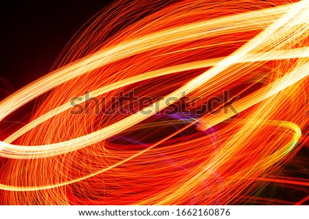 Abstract light pattern. Blurred neon lights. A dynamic backdrop for your design. Bright orange Royalty-Free Stock Photo #1662160876