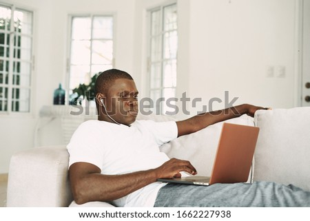 Cheerful man African appearance laptop home rest communication #1662227938