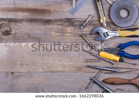group of repair tools on wooden background #1662298036