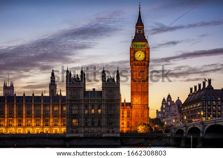 The illuminated Westminster Palace and Big Ben clock tower, major tourist attraction and Parliament in London just after sunset #1662308803