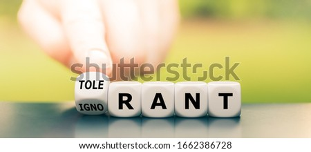 """Ignorant or tolerant? Hand turns dice and changes the word """"ignorant"""" to """"tolerant"""". #1662386728"""