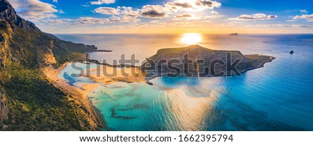 Amazing aerial view of Balos Lagoon with magical turquoise waters, lagoons, tropical beaches of pure white sand and Gramvousa island on Crete, Greece #1662395794