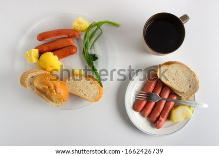 A simple lunch for two. Potato and sausages on a plate.