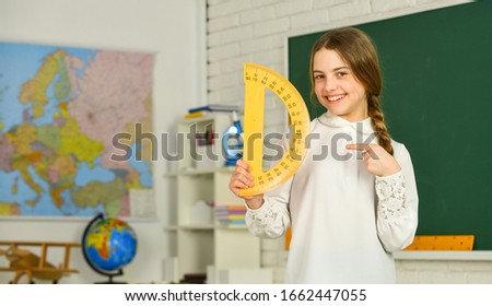 lets study together. Learning to use protractor. back to school. High school student learning geometry in class. measure angles. Small child girl holding school protractor for geometry lesson.