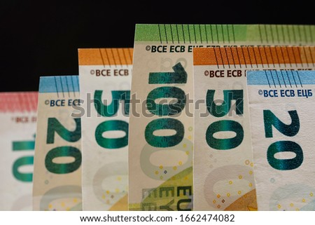 Various denominations of Euro money. The currency of the euro area have been in circulation since 2002 and Euro banknotes are not made of paper, but of pure cotton fiber to improve their durability. #1662474082