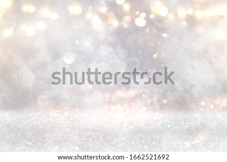 glitter vintage lights background. gold, silver and white. de-focused Royalty-Free Stock Photo #1662521692