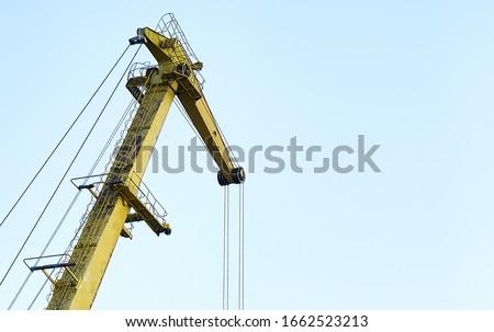 Yellow crane in cargo port translating coal. Industrial scene Royalty-Free Stock Photo #1662523213