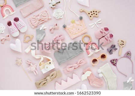 Set of  baby girl accessories on pink background. Various head band and hair bow, toy, little shoes, socks. Fashion kids stuff and accessories. Flat lay, top view Royalty-Free Stock Photo #1662523390