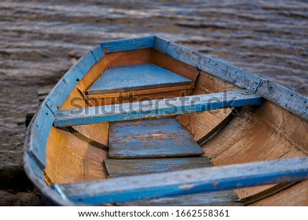 Old boat resting on the beach. Royalty-Free Stock Photo #1662558361