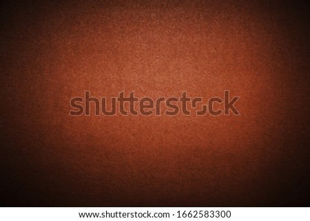 Bright brown background with vignetting. The texture of the cardboard
