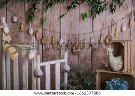 Happy Easter - colourful Easter decorations on a wooden background - eggs, chicken, flowers, natural elements  #1662597886