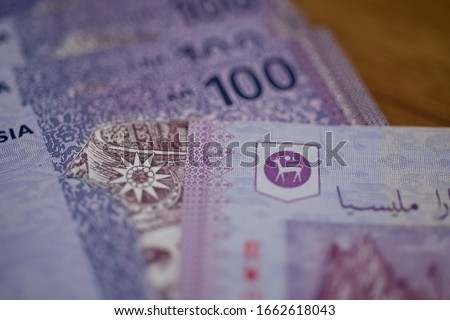 Malaysia currency of Malaysian ringgit banknotes background. Paper money of hundred ringgit notes on etreme closeup. Financial concept.