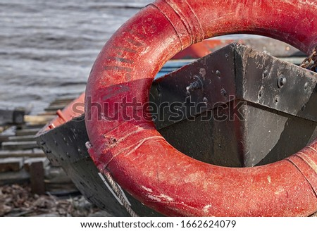 life buoy on the bow of an old boat. Royalty-Free Stock Photo #1662624079