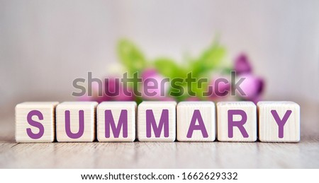 SUMMARY word written on wood cubes. Floral background #1662629332