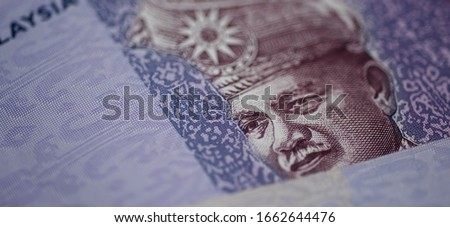 Malaysia currency of Malaysian ringgit banknotes background. Paper money of hundred ringgit notes etreme closeup. Financial concept.