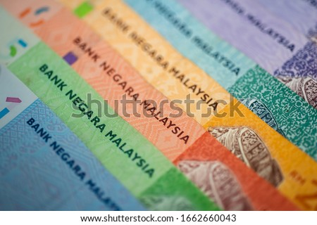 Malaysia currency of Malaysian ringgit banknotes background. Paper money of ten, twenty, fifty and hundred ringgit notes. Financial concept.