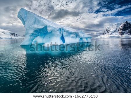 Large iceberg broken off of glacier floats near Antarctica