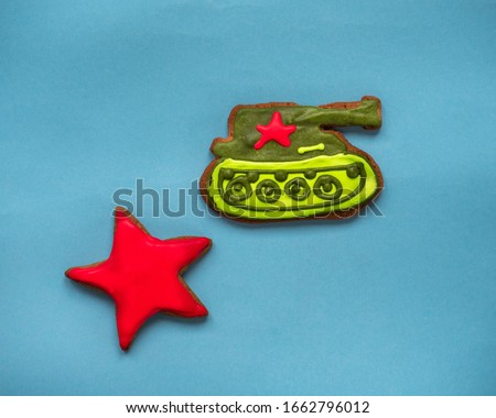 Greeting card for Victory Day, as well as for congratulations to men. In the picture, gingerbread cookies in the shape of a tank and stars