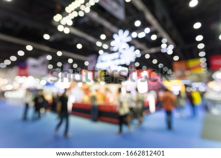 Abstract blur people in exhibition hall event trade show expo background. Large international exhibition, convention center, Business marketing and MICE industry concept. Royalty-Free Stock Photo #1662812401