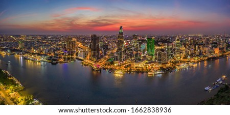 Aerial panoramic cityscape view of HoChiMinh city and the River Saigon, Vietnam with blue sky at sunset. Financial and business centers in developed Vietnam. View from Thu Thiem peninsula #1662838936