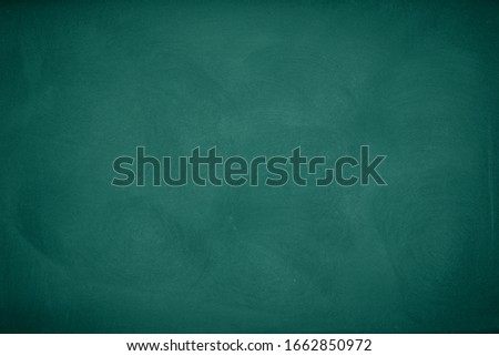 Green Chalkboard. Chalk texture school board display for background. chalk traces erased with copy space for add text or graphic design. Backdrop of Education concepts  #1662850972