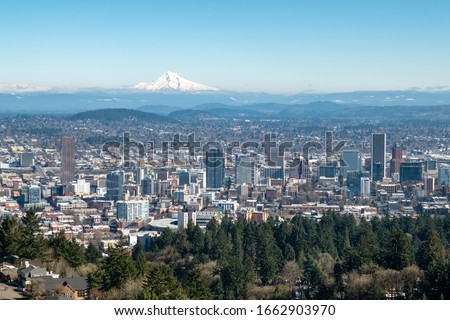 Downtown Portland, Oregon with Mount Hood in the background as seen from the Pittock Mansion viewpoint.