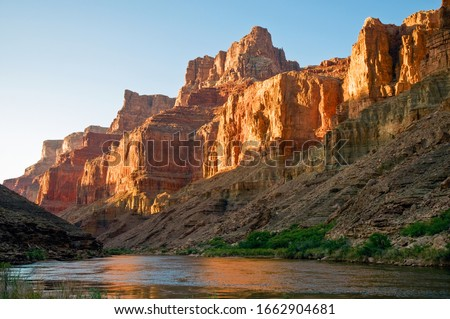Late afternoon sun reflects off the redwall limestone cliffs of the Grand Canyon #1662904681
