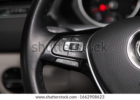 Novosibirsk, Russia – February 12, 2020:  Volkswagen Tiguan,Car controller on steerling wheel ,Music,Control System Function and voice telephone in car. modern car interior #1662908623