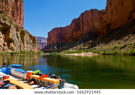 Campers on a tranquil stretch of the Colorado River  in the Grand Canyon in Arizona. #1662921445