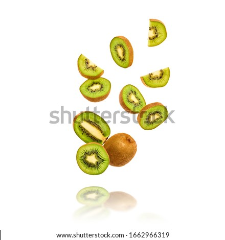 Fresh kiwi fruit flying in air on yellow. Fruity green color diet food. Summer whole, cut kiwi background. Colorful levitation concept. Falling fly kiwi, fruity creative vivid design #1662966319