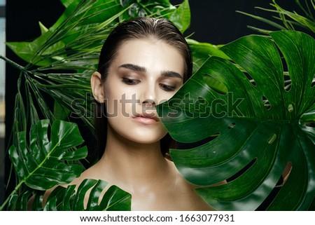 Green leaves guy beautiful woman clean skin cosmetology #1663077931