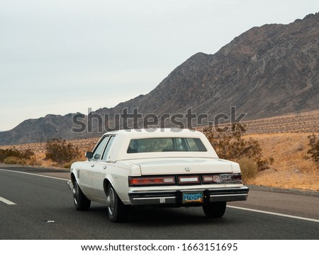 Mojave, United States - December 02, 2019: Car traffic by road in the Mojave Desert. #1663151695