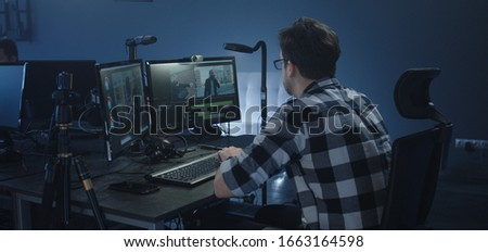 Medium shot of a film editor working on a movie